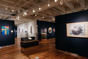 Exhibition Installation with dark blue walls.