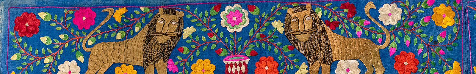 detail of embroidery with two lions