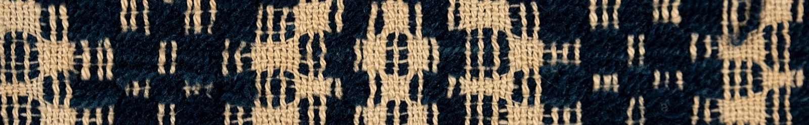 navy and cream woven quilt detail