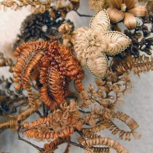 Detail of group of hairwork flowers showing various forms of looping.