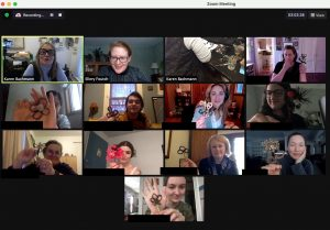 Screen shot of a zoom call in which all the participants are holding up their hairwork creations for the camera.