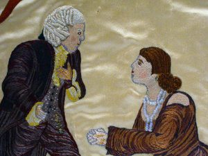Embroidery of a male and female figure
