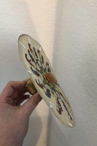 hand holding a homemade phanakitoscope disk