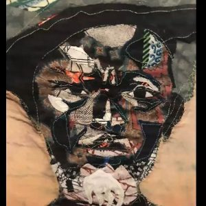 Quilted image of a bearded elderly African-American gentleman wearing a hat.