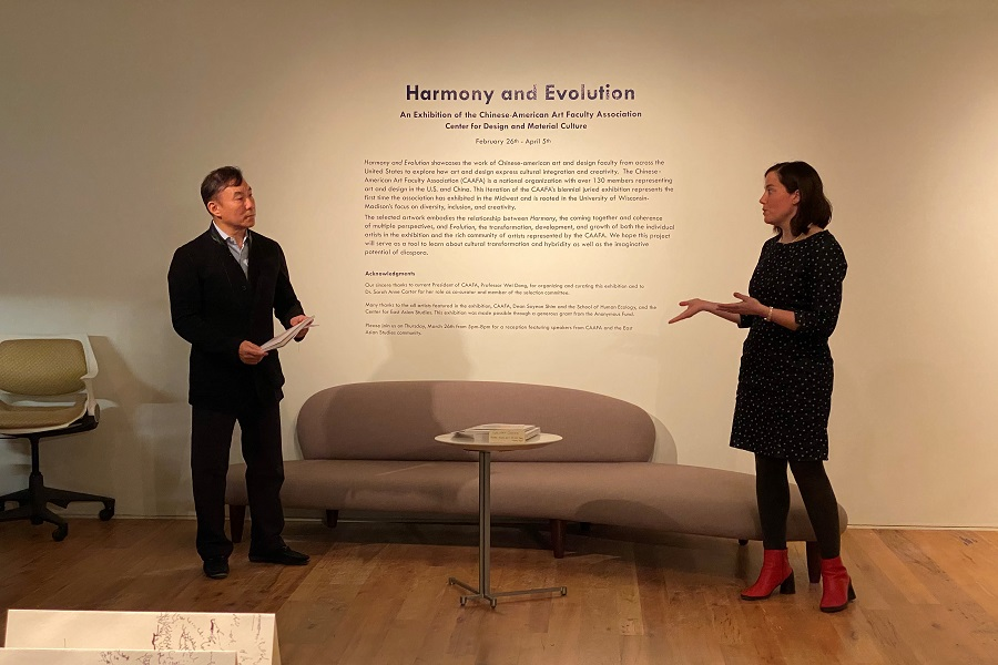 Wei Dong and Sarah Anne Carter speaking in gallery.