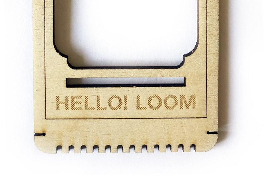 Photograph of a close up on the bottom of an empty hello loom