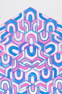 print of pink, purple, and light blue U-forms stacked on top of each other in shape of an arrow