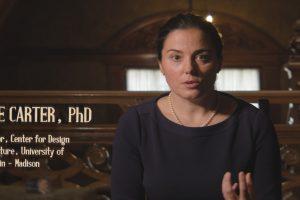 film still showing Sarah Anne Carter speaking inside the Pabst mansion.