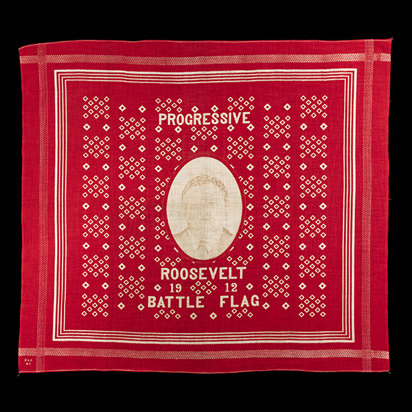 red, square handkerchief with an image of Theodore Roosevelt in the center